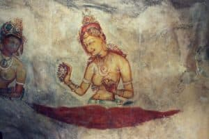 The frescoes in Sigiriya (Lion Rock) shows 500 ladies in varies paintings in an area 140 meters long and 40 meters high. One of the tourist attractions.